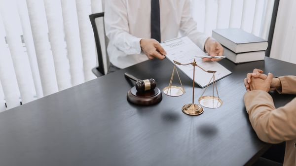 lawyer helping client through the criminal defense process